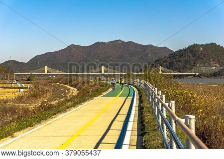 Mokpo, South Korea - November 17, 2018: Korean Bicycle Path Pass Through The Field Full Of Straw Bal