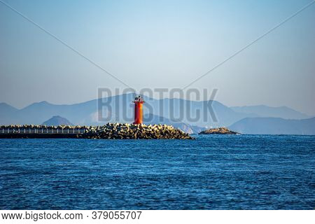 Red Beacon On The Tip Of Tetrapod Breakwater In The Bay Of Okpo In Okpo, Gyeongsangnam-do,south Kore