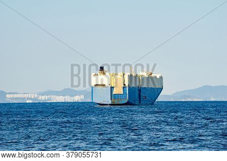 Large White And Blue Roll-on/roll-off (roro Or Ro-ro) Ships Or Oceangoing Vehicle Carrier Ship Ancho