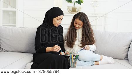 Muslim Young Mother In Black Hijab And Abaya Dress Drawing And Coloring Picture With Small Teen Daug