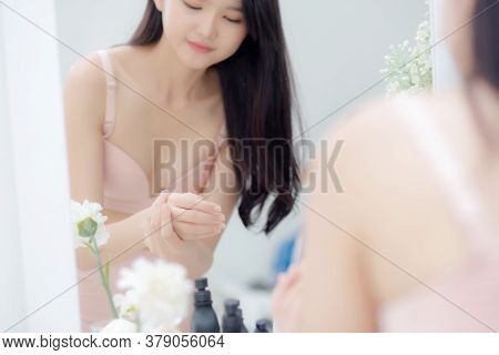 Beautiful Sexy Young Asian Woman Looking Mirror Applying Cream On Hand And Message, Beauty Girl Appl