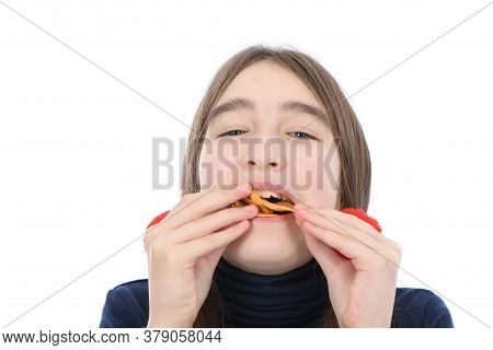 Portrait Of Pre-adolescent Girl Teste Potato Chips. Isolated On White Background. High Resolution Ph