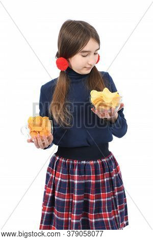 Pre-adolescent Girl Weigh Two Bowls Full Of Potato Chips. Isolated On White Background. High Resolut