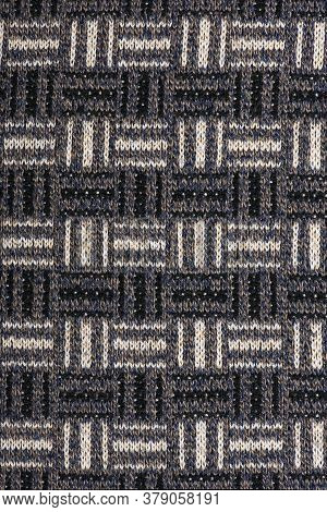 The Texture Of A Knitted Wool Brown. Background. High Resolution Photo. Full Depth Of Field.