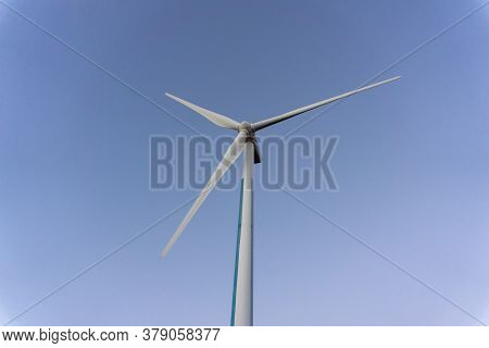 White Wind Power Turbines Or Windmill Generators Farm For Producing Electricity With Renewable Energ