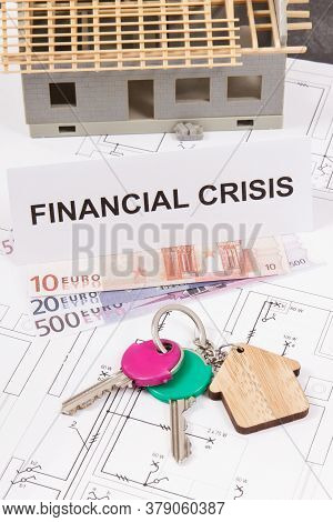 Keys With Home Shape, Currencies Euro And Inscription Financial Crisis On Electrical Construction Dr