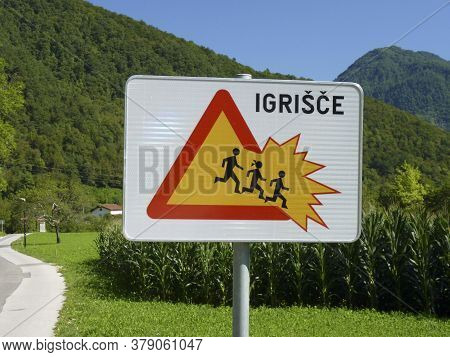Traffic Sign Attention Children Crossing (igrisce) At A Warning Sign In Slovenia