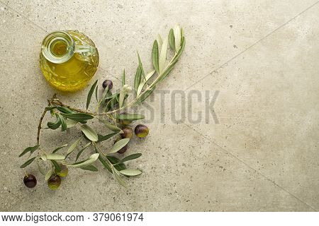 Olive Oil And Branch With Olives And Leaves Background Close Up. Healthy Olive Oil Concept