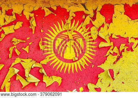 The National Flag Of Kyrgyzstan  Is Painted On An Old Metal Wall With Ragged Paint. Country Symbol.