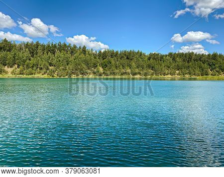 Blue Lake And Green Forest On A Sunny Summer Day In Belarus