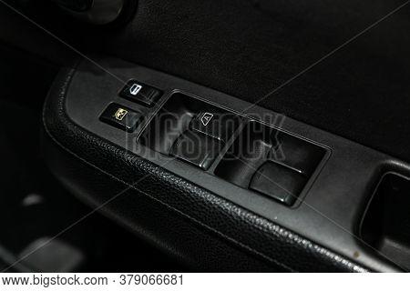 Novosibirsk/ Russia - July 26 2020: Nissan Tiida Latio, Interior Of Modern Car. Side Door Buttons: W