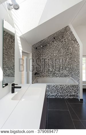 Vertical View Of Modern House With Contemporary Interior Design In Bathroom, White Tub, Sink On Coun