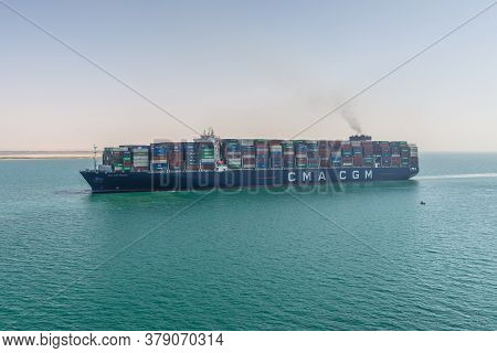 Suez, Egypt - November 14, 2019: Large Container Vessel Ship Cma Cgm Mexico Passing Suez Canal In Eg