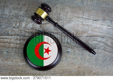 Wooden Judgement Or Auction Mallet With Of Algeria Flag. Conceptual Image.