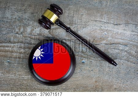 Wooden Judgement Or Auction Mallet With Of Taiwan Flag. Conceptual Image.