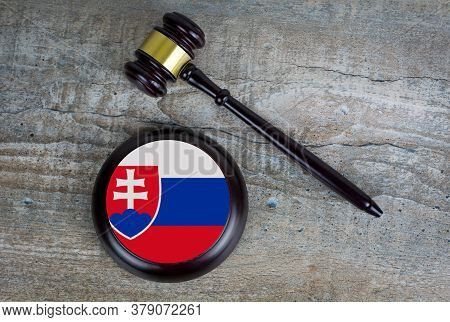 Wooden Judgement Or Auction Mallet With Of Slovakia Flag. Conceptual Image.
