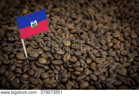 Haiti Flag Sticking In Roasted Coffee Beans. The Concept Of Export And Import Of Coffee