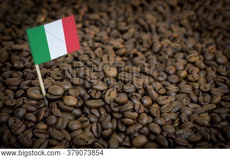 Italy Flag Sticking In Roasted Coffee Beans. The Concept Of Export And Import Of Coffee