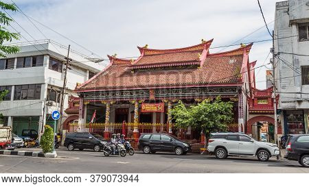 Surabaya, Indonesia - November, 04, 2017: Street View With Chinese Temple, Bicycle Taxi And Other Tr