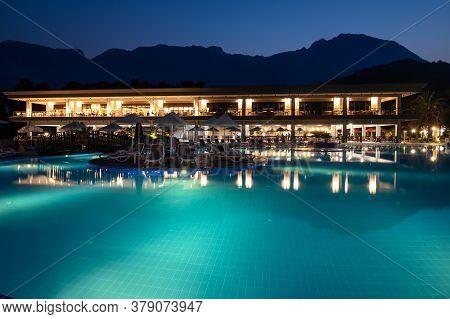 Kemer, Turkey, July 26, 2020: Illuminated Evening Swimming Pool At The Hotel Kimeros Park Holiday Vi