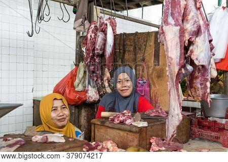 Surabaya, Indonesia - November, 05, 2017: Two Ladies Selling Meat At The Market In Surabaya In Indon