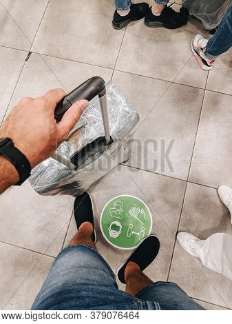Tivat, Montenegro - 29 July 2020: Close-up Of A Hand Holding The Handle Of A Suitcase Rewound With F