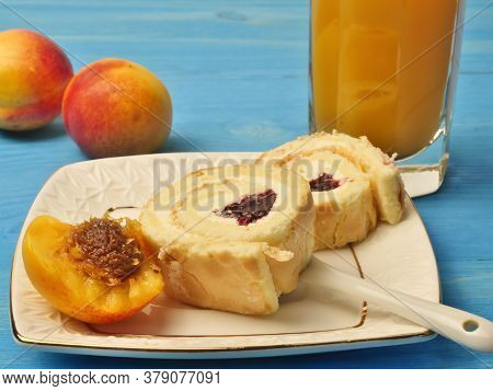 A Glass Of Apricot Juice, Beautiful Apricots, Buns On A Plate With Cherries, On A White Saucer, On A