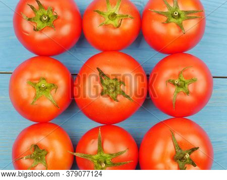 Red Tomatoes On A Blue Background, Close-up. Proper Nutrition. Dietary Products. Lifestyle.