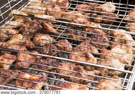 Fresh Juicy Cuts Of Meat On A Barbecue Grill, Selective Focus. The Concept Of Cooking Healthy Food O