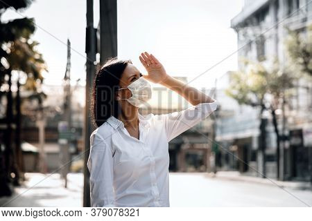 Weather, Pollution And Ecology Issue Concept. Young Woman Wearing Protection Mask Against Roadside I