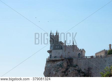 Beautiful Castle Swallow's Nest On The Black Sea Coast In Crimea Against The Background Of Blue Sky