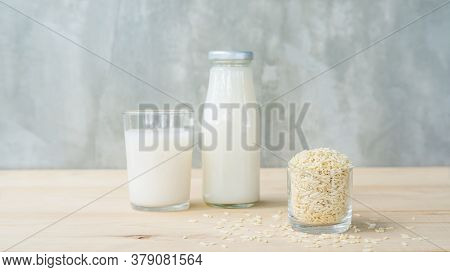 Germinated Brown Rice Drink And Brown Rice On A Wooden Table.