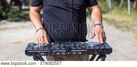 Dj With Headphones And Mixer In The Park, The Dj At Work