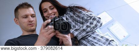 Photographer In Office Shows Photo Model In Camera. Consultant Adjusts Activities Company As Whole.