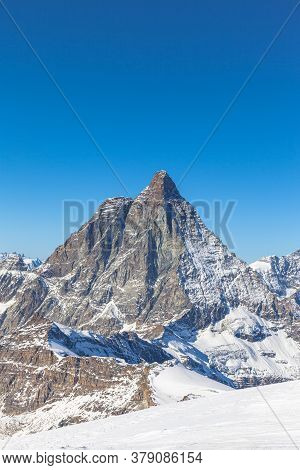 Stunning Panorama View Of Famous Matterhorn, Weisshorn And Pennine Alps On Swiss Italien Border On S