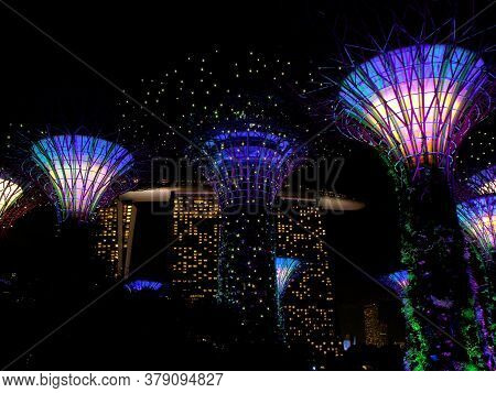 Singapore, March 6, 2016: Night View Of The Artificial Trees Of The Gardens Of The Bay With The Hote