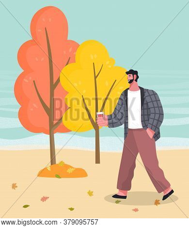 Man Walk In Autumn Forest Or Wood Alone. Guy Drinking Coffee While Strolling Through Lawn. Beautiful