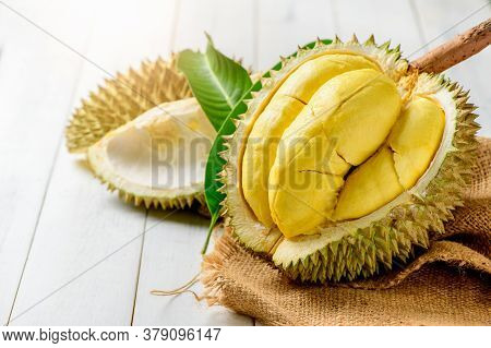 Fresh Durian (kan Yao) Or Durio Zibthinus Murray On Sack And Old Wood Background, King Of Fruit From