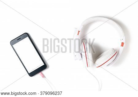 White Headphones And Mobile Phone With White Screen Isolated On White Background