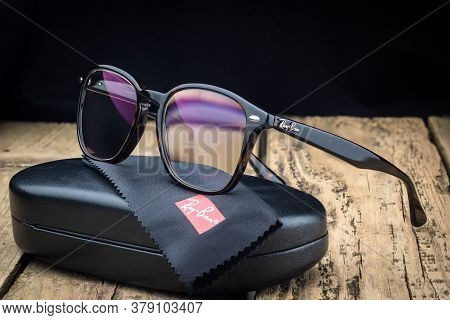 Russia. St. Petersburg / June 20, 2020: Ray Ban Glasses Frame On A Wooden Background