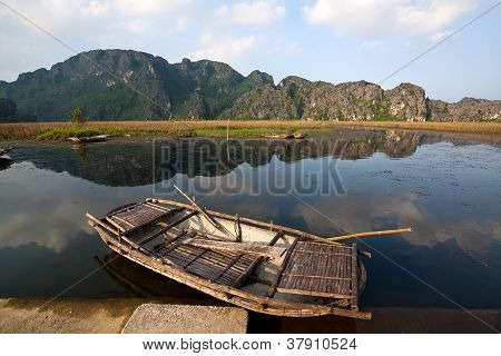 Landscape With Boat, Mountains And Clouds Van Long Natural Reserve (ninh Binh, Vietnam)