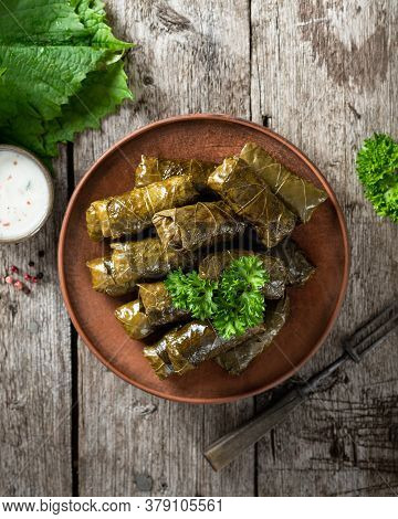 Dolma On A Wooden Rustic Background. Traditional Caucasian, Turkish And Greek Cuisine, Top View
