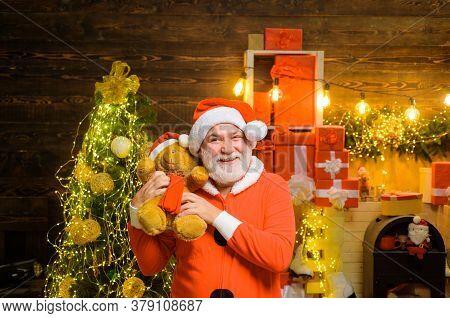 Santa Claus Holds Plush Toy. Christmas Holidays. Christmas Decoration. Merry Christmas. Happy New Ye
