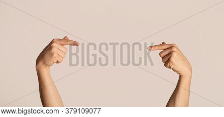 Closeup View Of Millennial Guy Pointing At Something On Light Background, Mockup For Design
