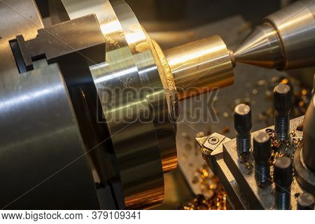 The Operation Of Lathe Machine Cutting The Brass  Shaft Parts With The Cutting Tools. The Metalworki