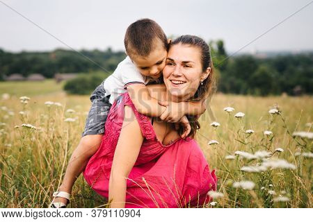 Lifestyle. Sincere Moments Of Family. Child Sits On Shoulders Mother. Leisure, Childhood. Happy Fami