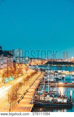 Helsinki, Finland - December 10, 2016: View Of Pohjoisranta Street And Ships, Boats And Yachts Moore