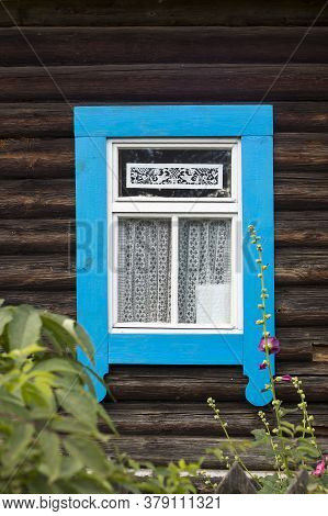 Russian Windows With Blue Carved Frames And Shutters In Village Houses