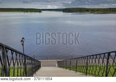 View Of The Volga From The Side Of The Embankment Of The City Of Myshkin Through Carved Gates And St
