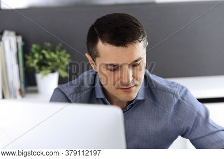 Businessman Working With Computer In Modern Office. Headshot Of Male Entrepreneur Or Company Directo